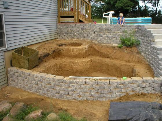 Bickal koi farm koi pond consultation lisbon iowa for Digging a koi pond